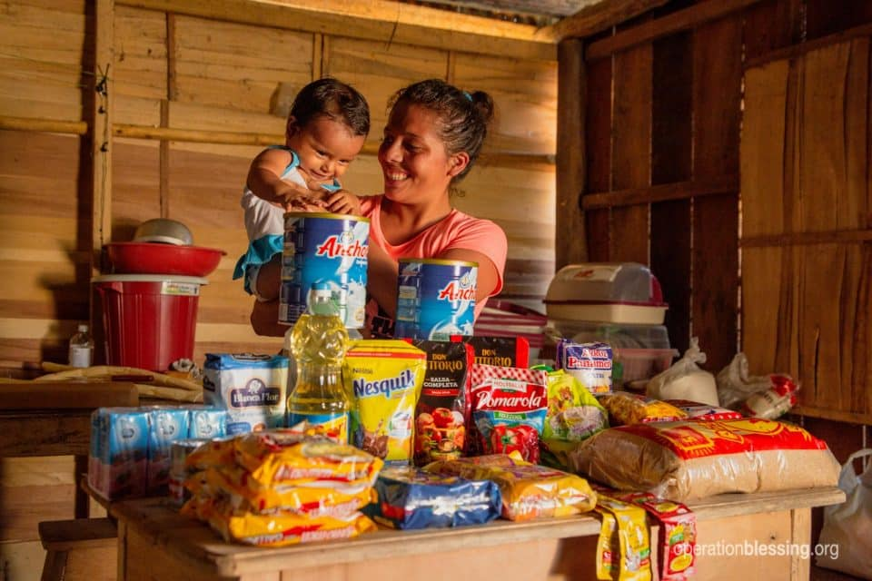 Alany and her daughter with supplies from Operation Blessing.