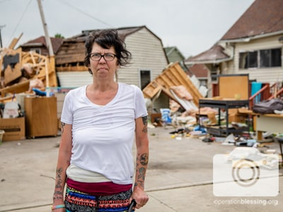 A woman receiving tornado relief from Operation Blessing in Dayton, Ohio.