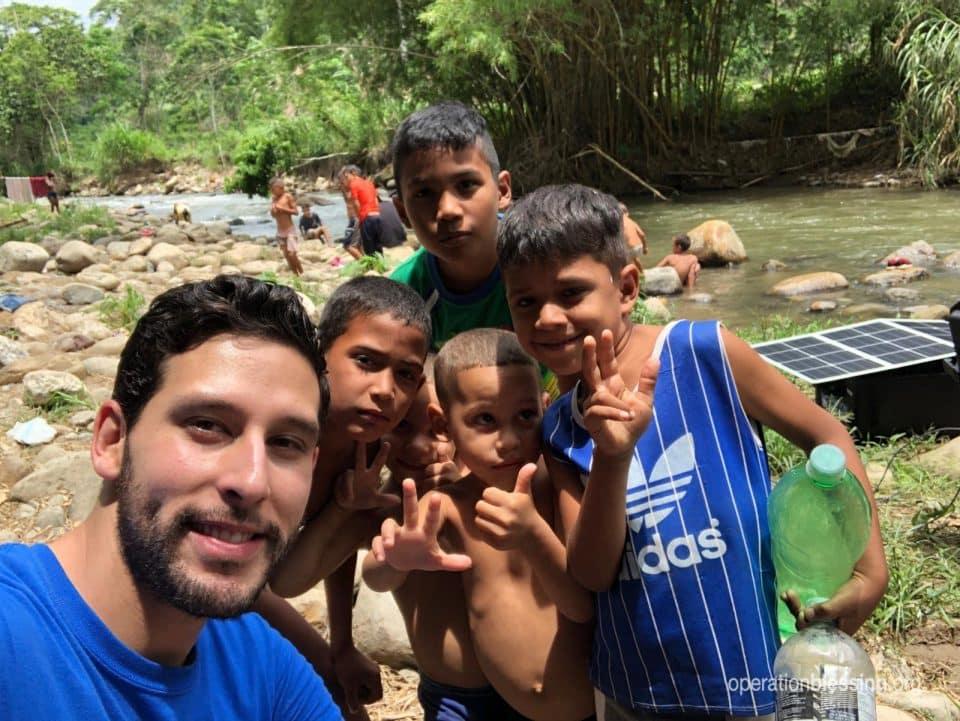 Roberto Torres hangs out with Venezuelan refugee children.