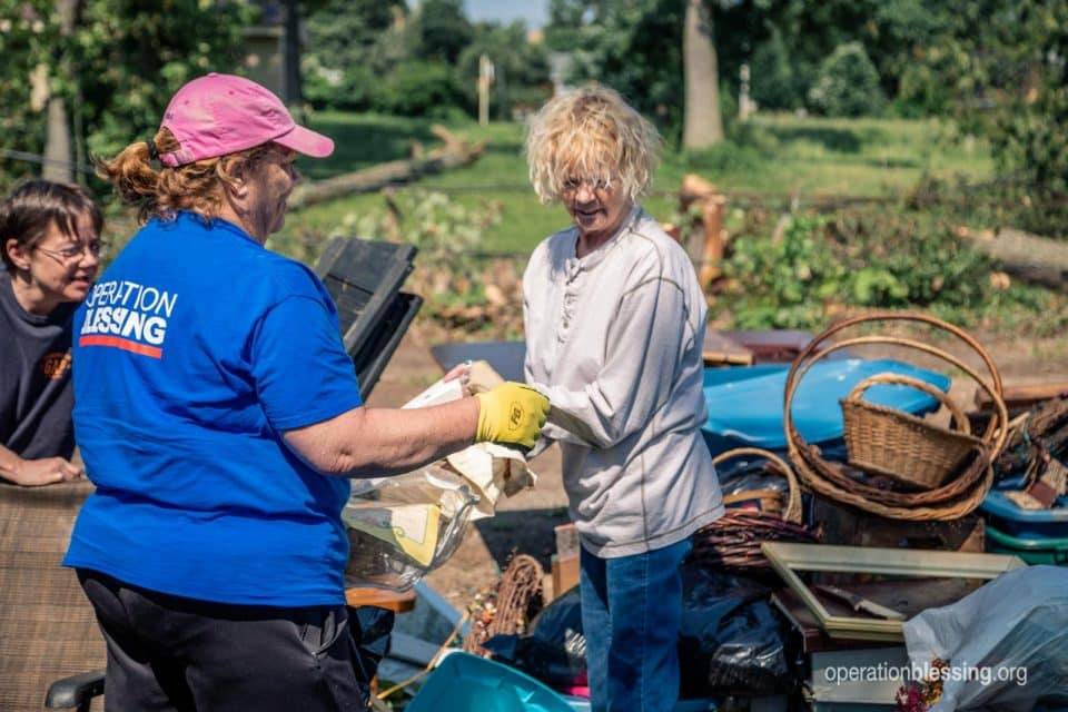 One of Anita's angels helping her sort through the debris.