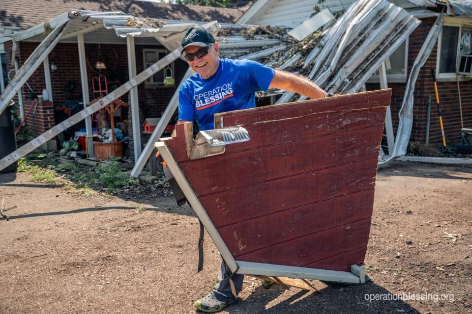 An Operation Blessing volunteer providing clean up and tornado relief.