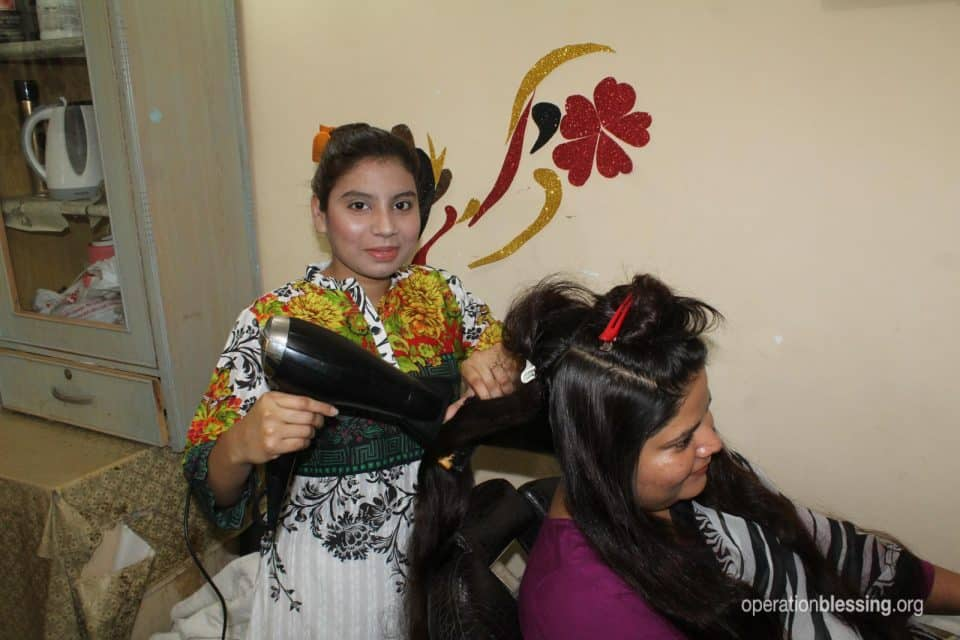 This woman doing hair can now provide food for her family.