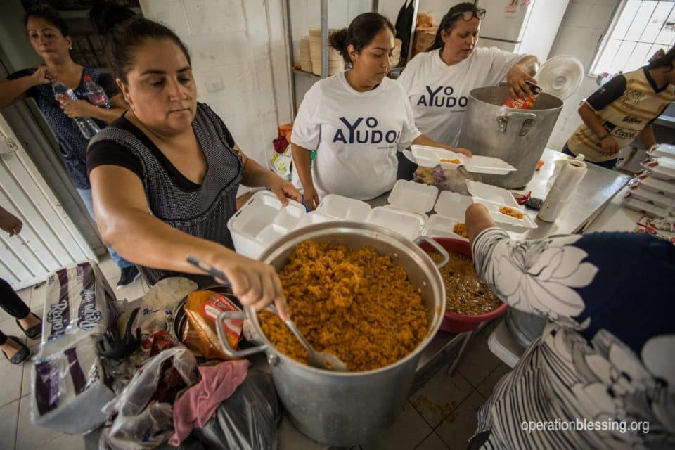 A woman stirs pot to feed disaster victims in Mexico.