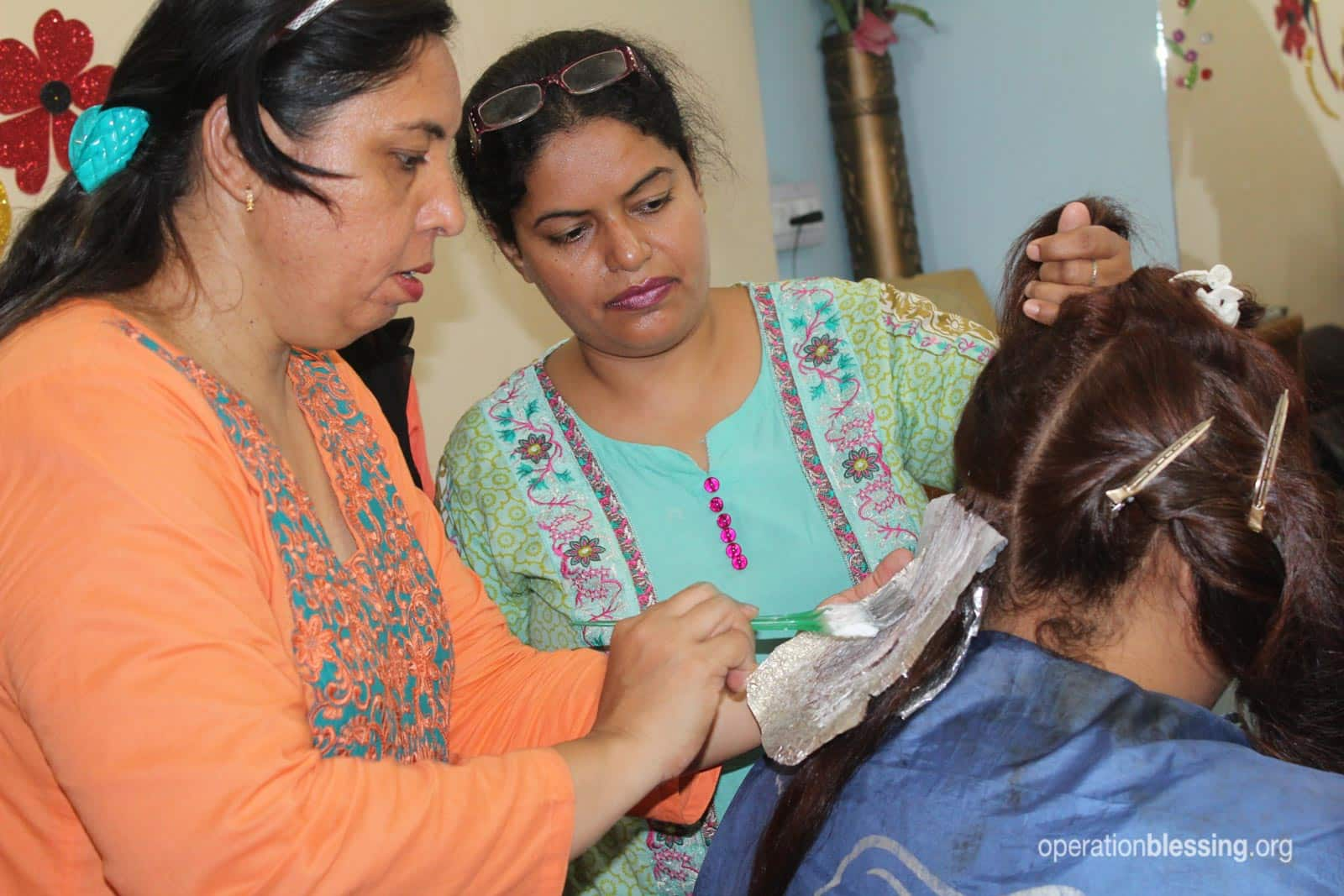 Rehana learning hair styling skills for breaking out of poverty