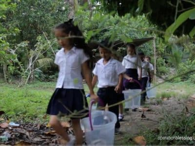 These children hauling buckets were struggling without safe water in Guatemala.