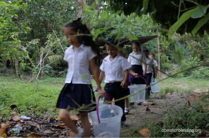 These children hauling buckets were suffering without clean water in Guatemala.