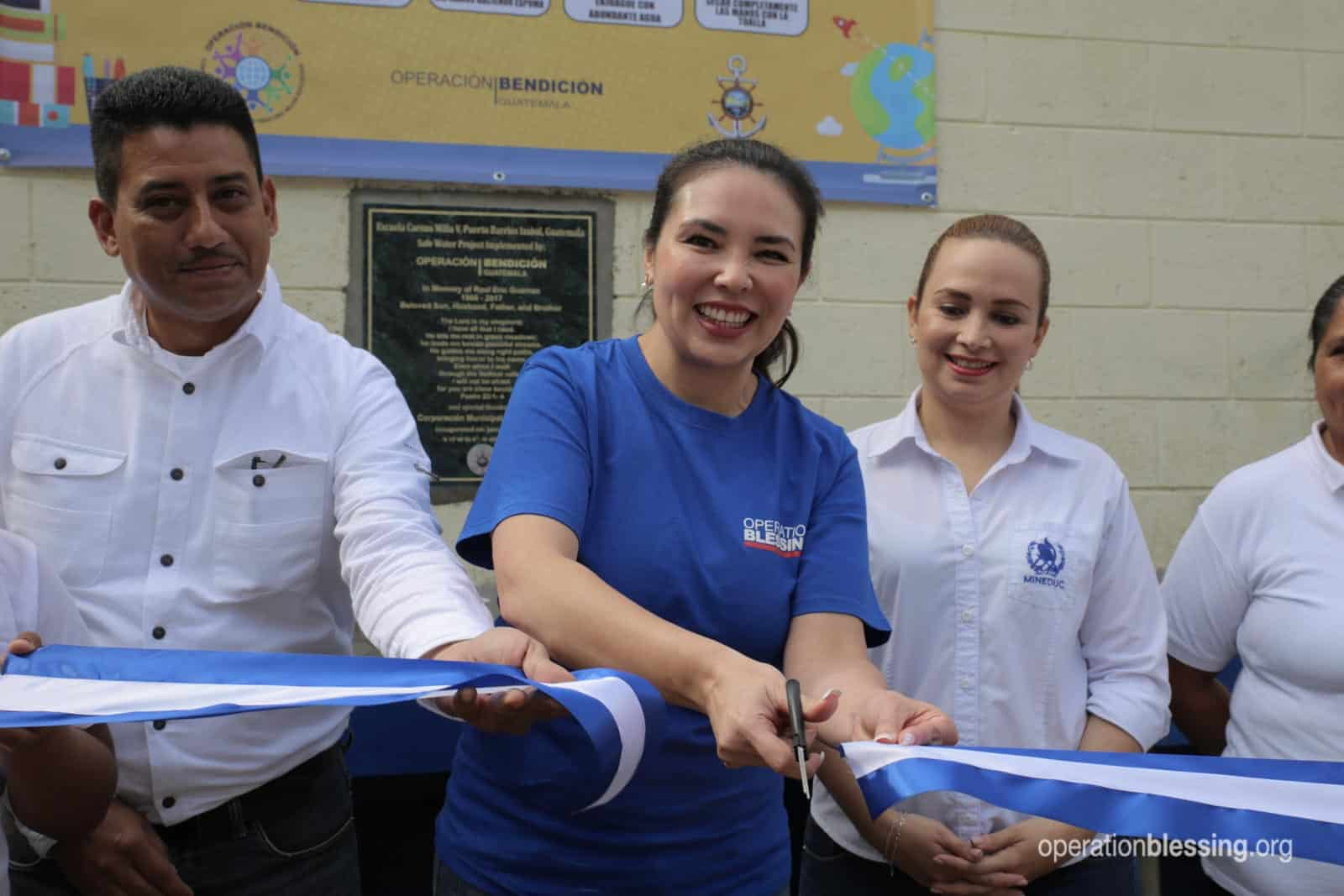 Cutting the ribbon on the safe water project in Guatemala