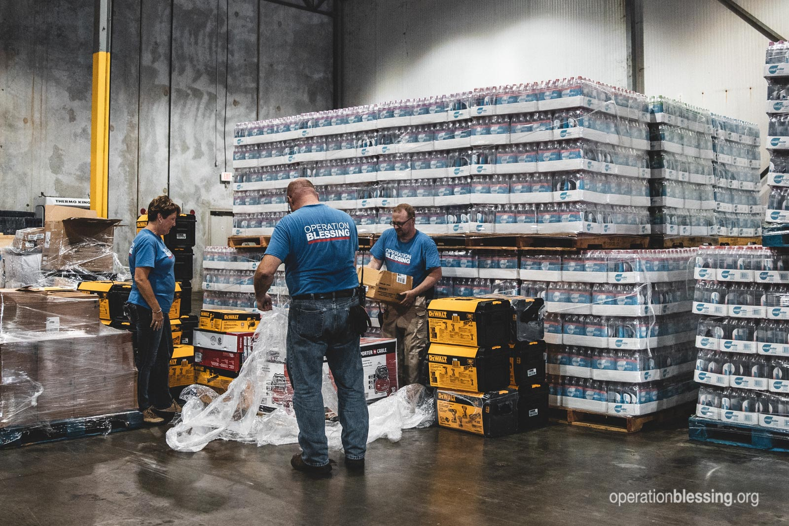 Preparing disaster relief supplies at our warehouse in Florida