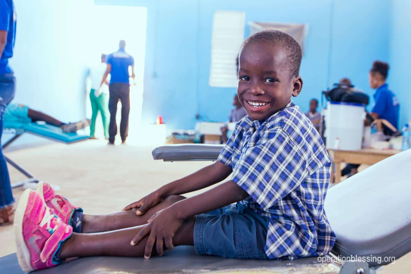 Boy smiling after seeing a dentist in Haiti.