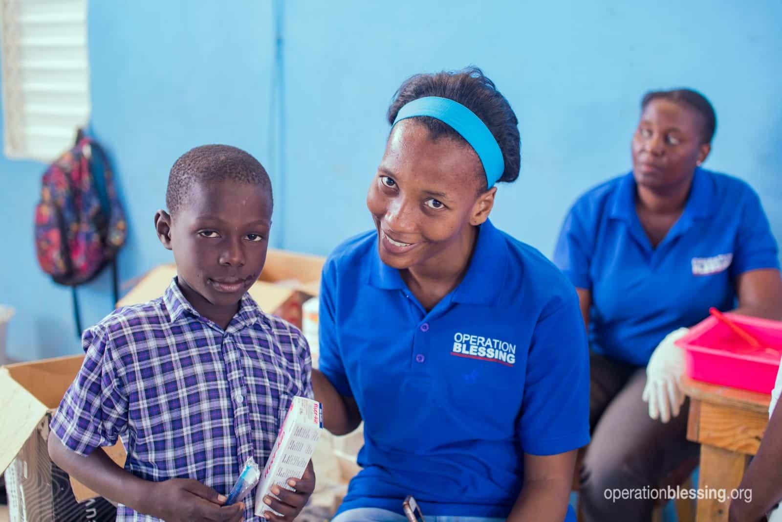 Haitian boy receiving oral hygiene kit.