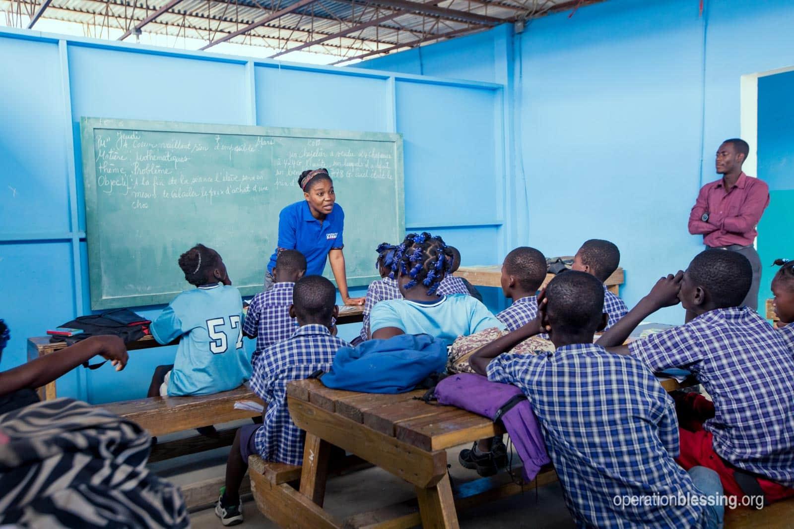 Haitian students attend an oral hygiene class.