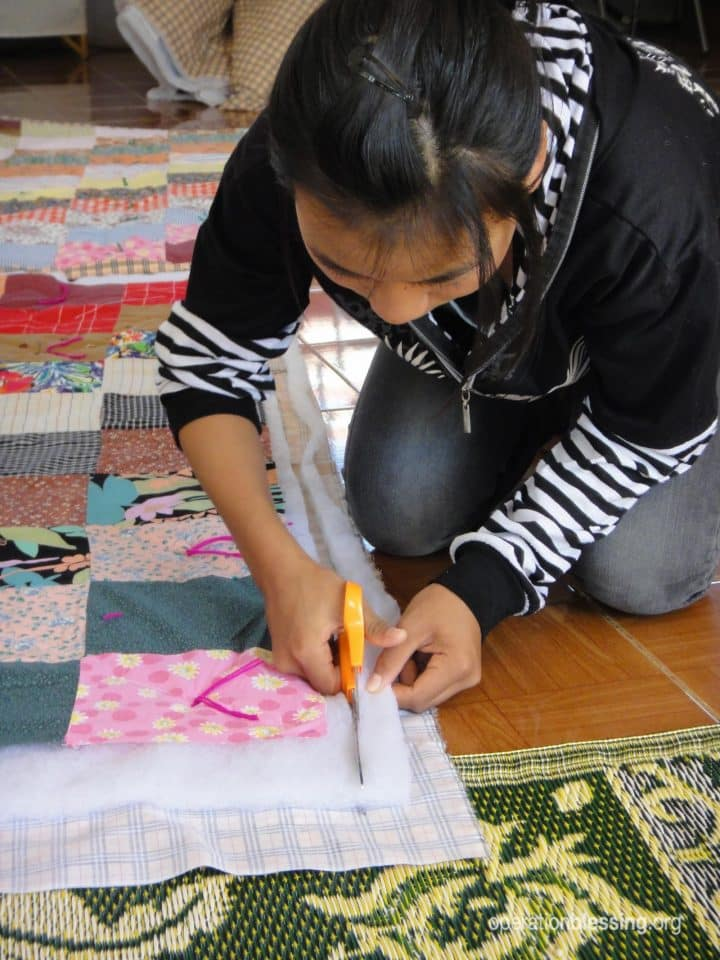 Human trafficking victim given new life and learning to sew