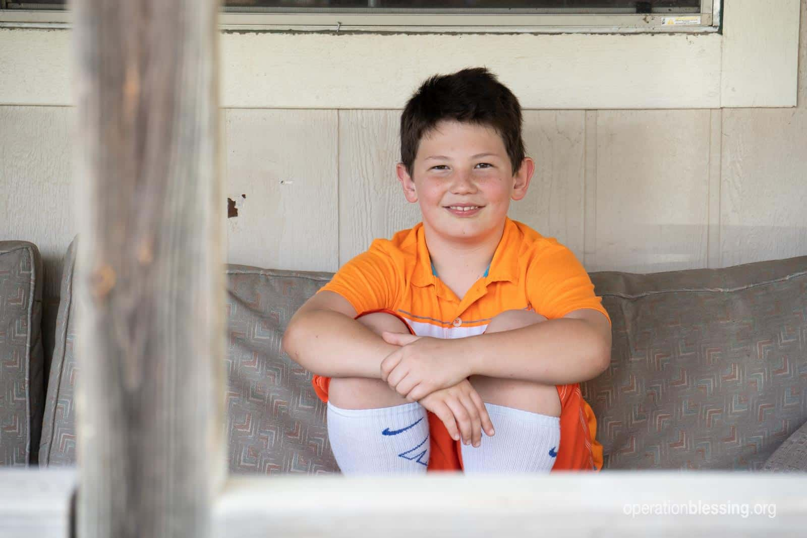 Hunter sits on his porch.