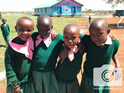 Smiling children who attend an Operation Blessing school in rural Kenya.