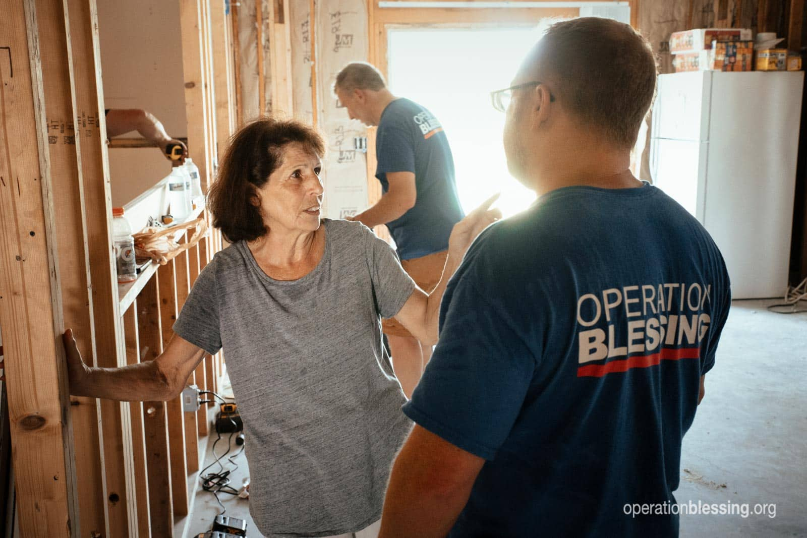 Ms. Peterson talking with Operation Blessing volunteers.