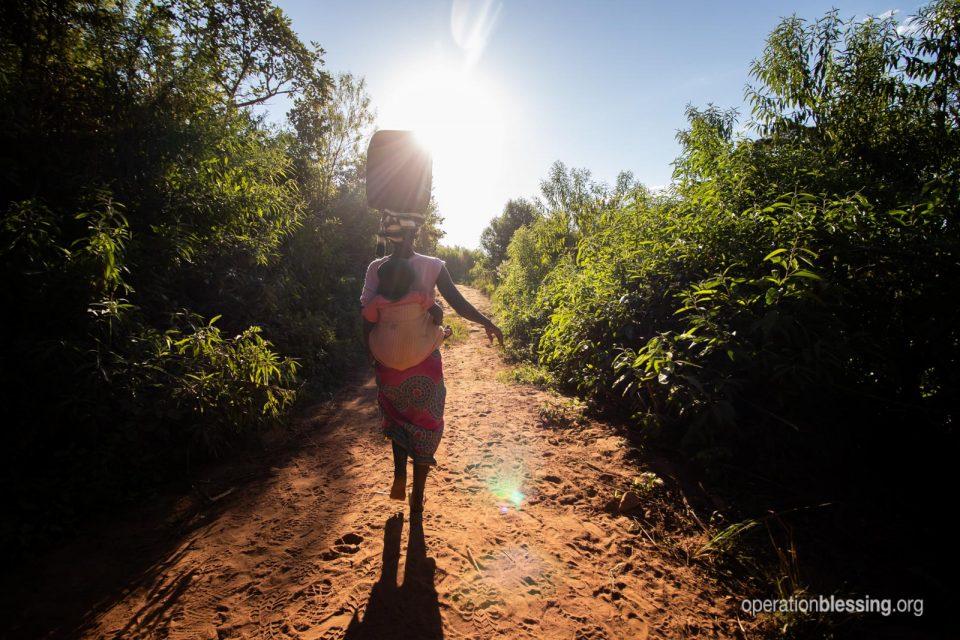 Idah and Simon walking into a beautiful sunset in Zimbabwe