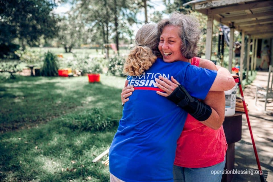 Blessings have come back to Brenda as she gets disaster relief help and a hug.