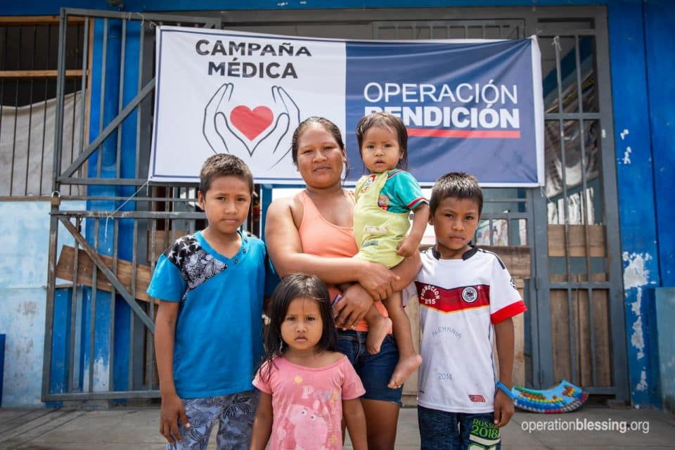 Celina and her children at the free OB medical clinic in the Amazon.
