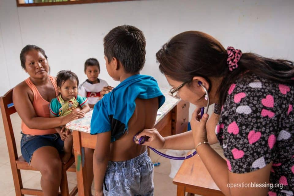A young boy in Peru gets a free health exam.