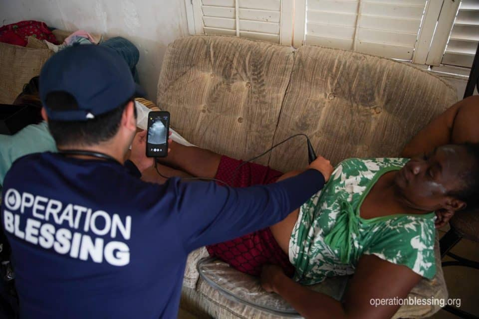 A hurricane victim getting a free ultrasound from Operation Blessing.