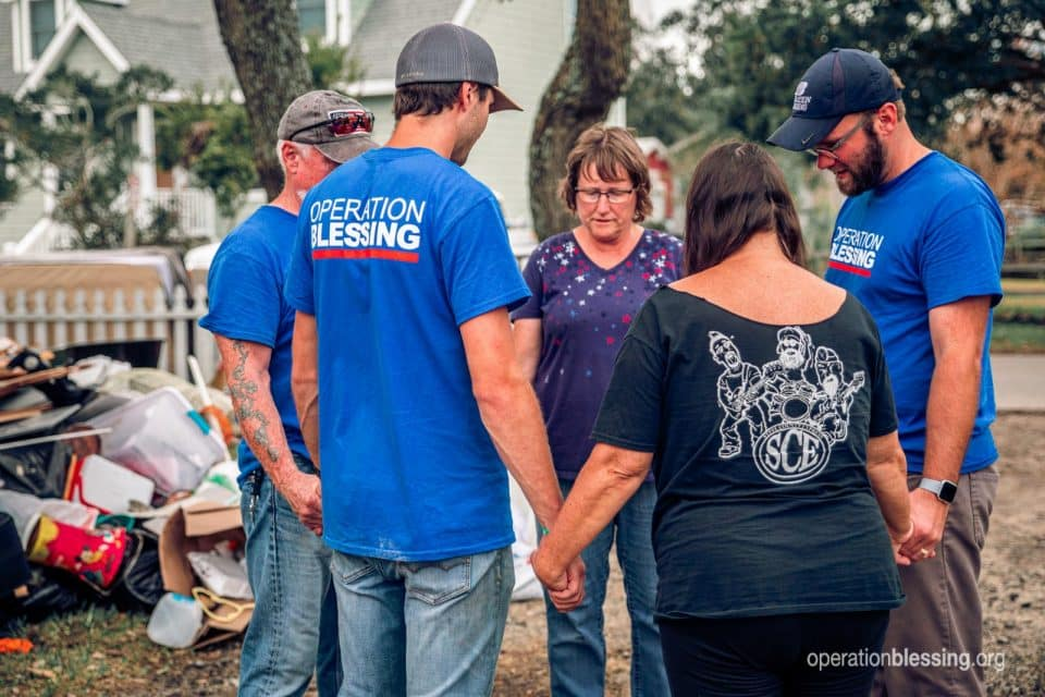 Operation Blessing is serving and praying with hurricane victims.