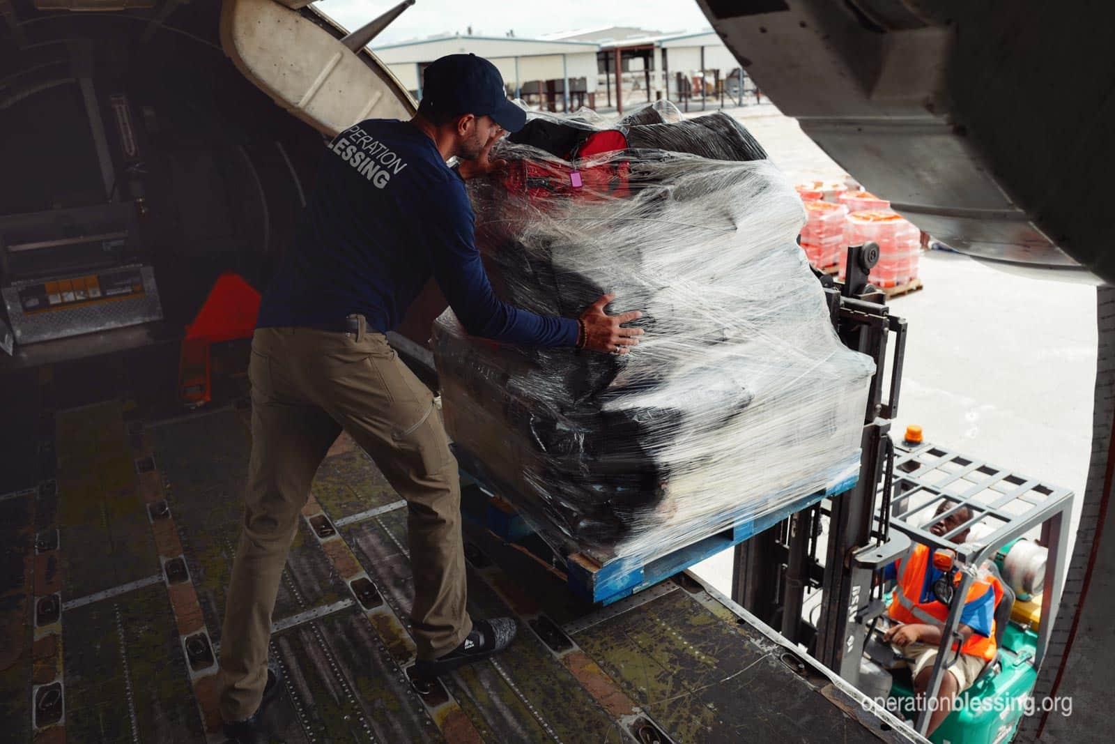 Plane unloading humanitarian supplies in the Bahamas.