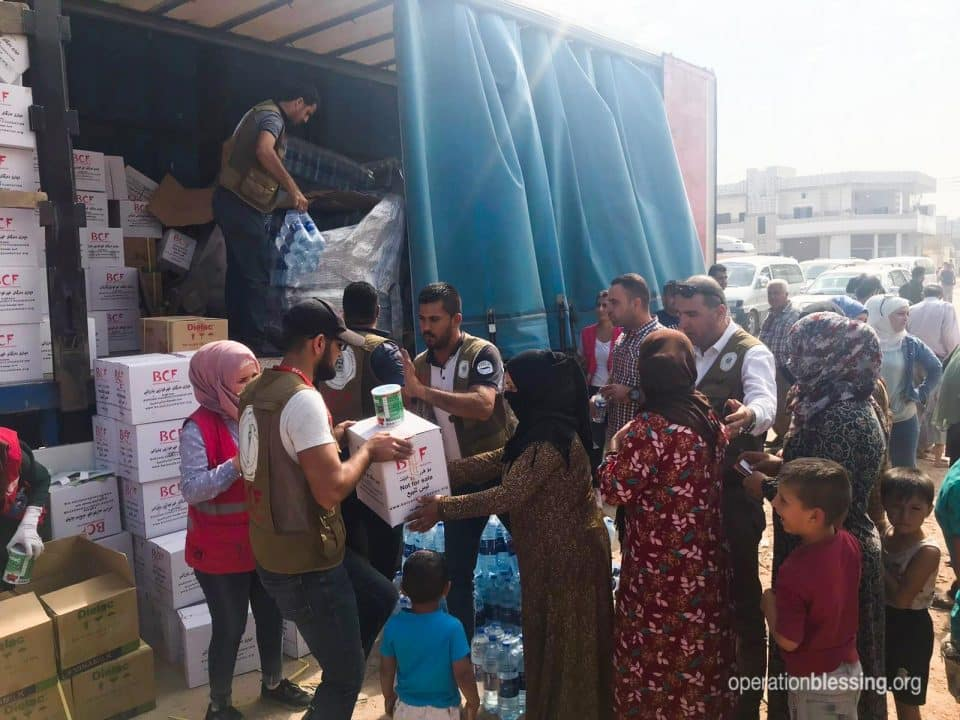 Distributing aid packages to Kurdish and Syrian refugees.