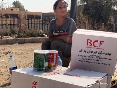 Kurdish refugees from Syria get aid boxes thanks to Operation Blessing friends.
