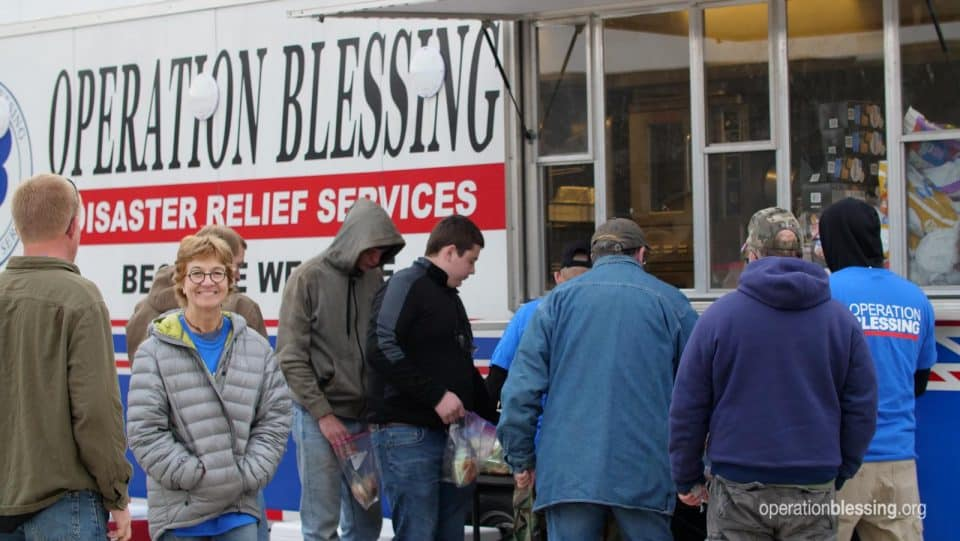 Serving hot meals to disaster victims from our mobile kitchen.