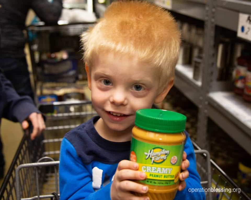 Susan's little brother holding peanut butter