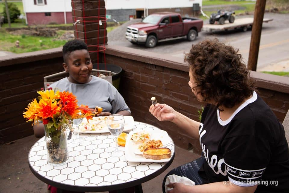 Tina and Josiah enjoy a healthy meal thanks to Operation Blessing friends.
