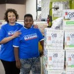 Tina and her foster son Josiah volunteer with Operation Blessing.