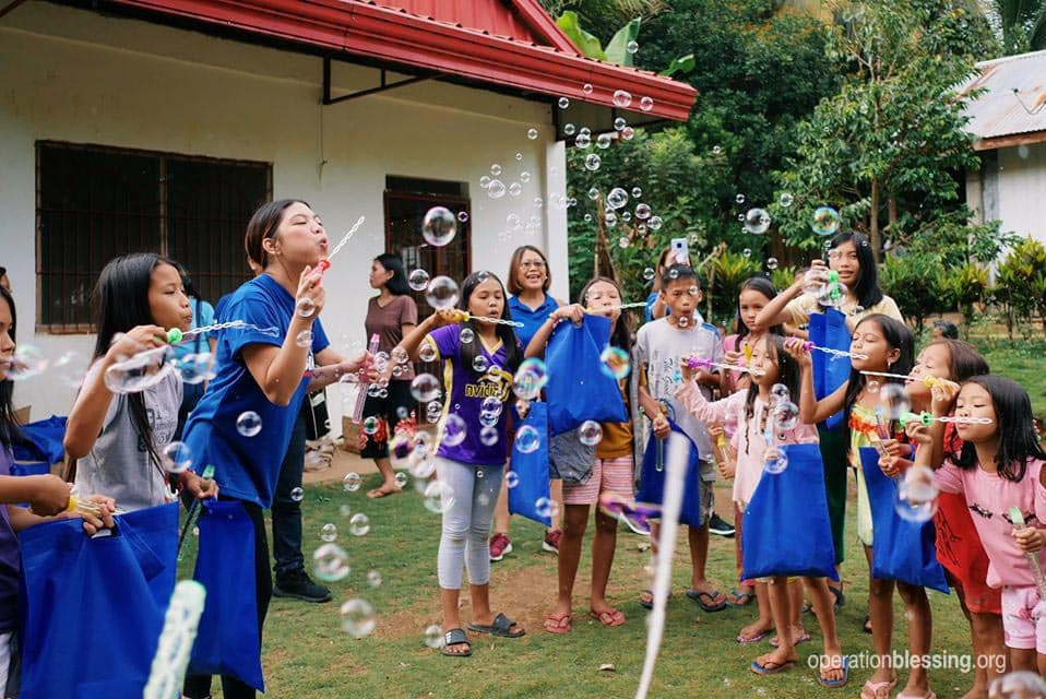 Children playing with bubbles following the Philippine earthquake