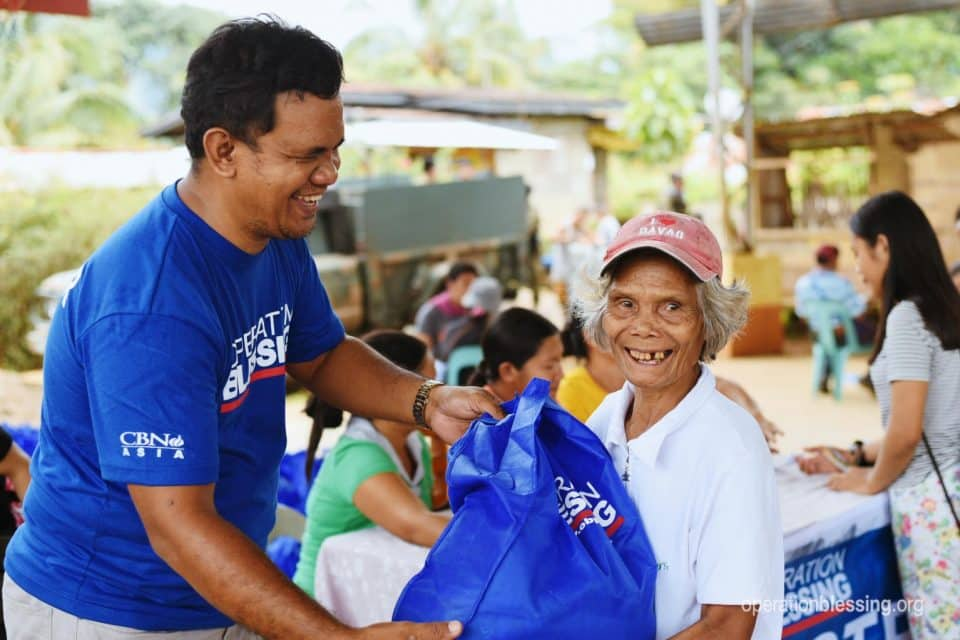 Disaster relief pack being given to elderly women in the Philippines