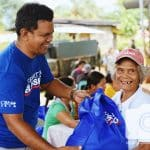 Elderly victim of 2019 Philippine Earthquake received relief supplies.