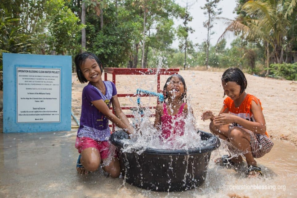 Children play in water well in Thailand this year.