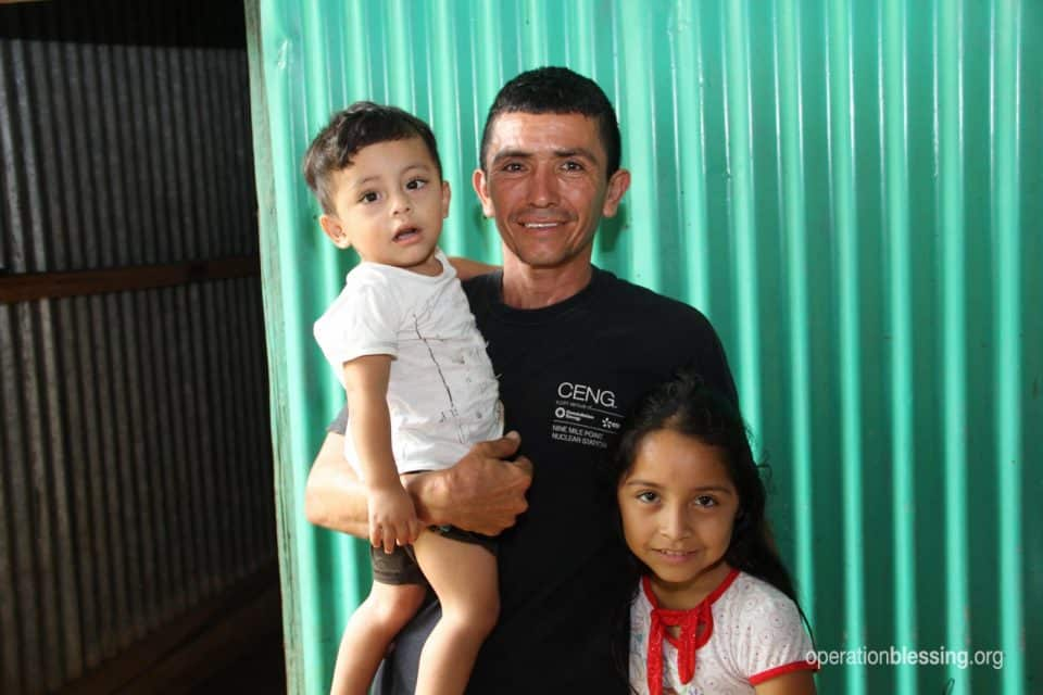 Single father Mario from El Salvador with his children.
