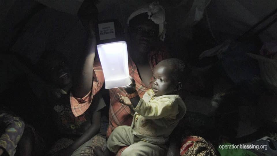 Baby touching a solar lamp.