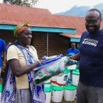 Kenyan landslide victims get disaster relief supplies.