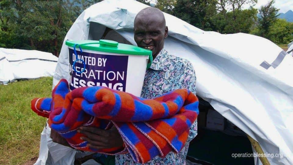 Simon, Kenyan landslide survivor, with his supplies.