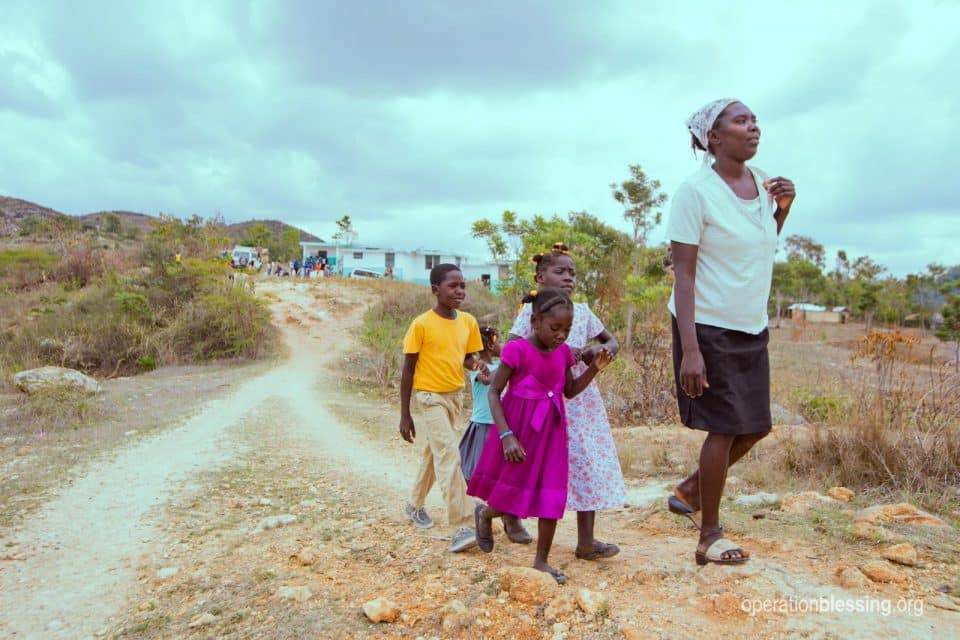 Family receives medical care in Haiti.