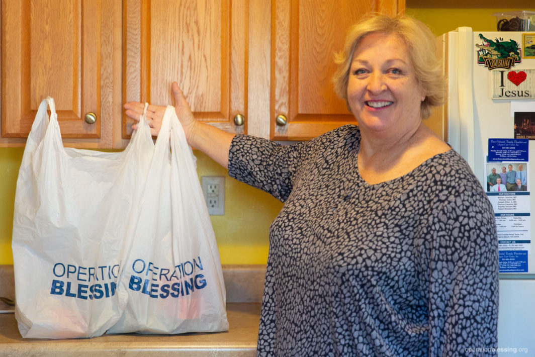 Stacie displays her groceries on her counter.