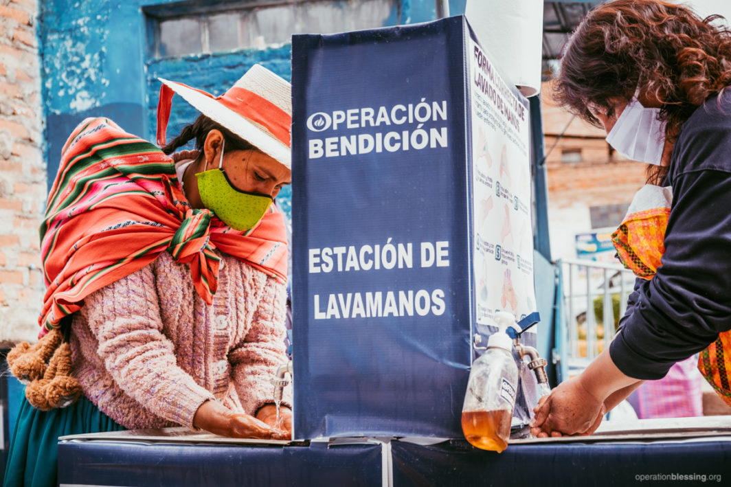 Hand washing stations help fight COVID-19 in Peru.